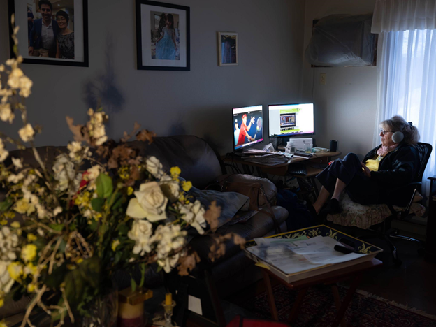 Photo of a woman watching Italian sports channels at home on her desktop