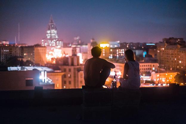A couple admiring Rome's night landscape
